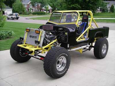 2002_Jeep_Roadster__Yellow___Black___Black.jpg