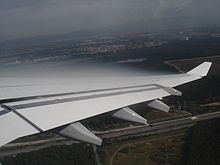 220px-Cloud_over_A340_wing.jpg