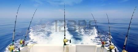 8051629-boat-fishing-trolling-panoramic-rod-and-reels-blue-sea-wake.jpg
