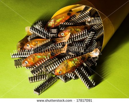 -chips-rubber-or-plastic-fishing-lures-and-computer-chips-in-a-yellow-paper-cone-with-a-17817091.jpg