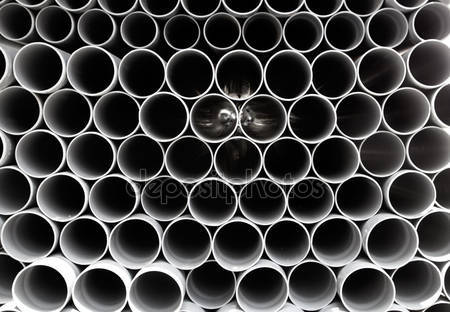 dep_6946686-Gray-PVC-tubes-plastic-pipes-stacked-in-rows.jpg