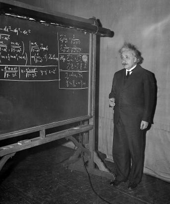 einstein-at-blackboard-chalk-in-hand.jpg