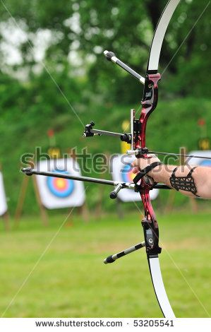 -photo-archer-pulls-on-the-sport-bow-string-taking-aim-at-his-target-at-the-competition-53205541.jpg